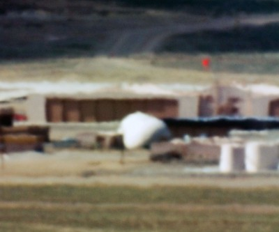 Limit Telephotography: Gallery, San Francisco; Large Hangars and Fuel Storage / Tonopah Test Range, NV/ Distance ~ 18 miles/ 10:44 am (2005)